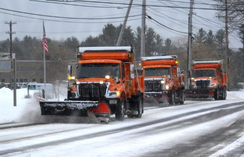 3 snow plows clearing the road