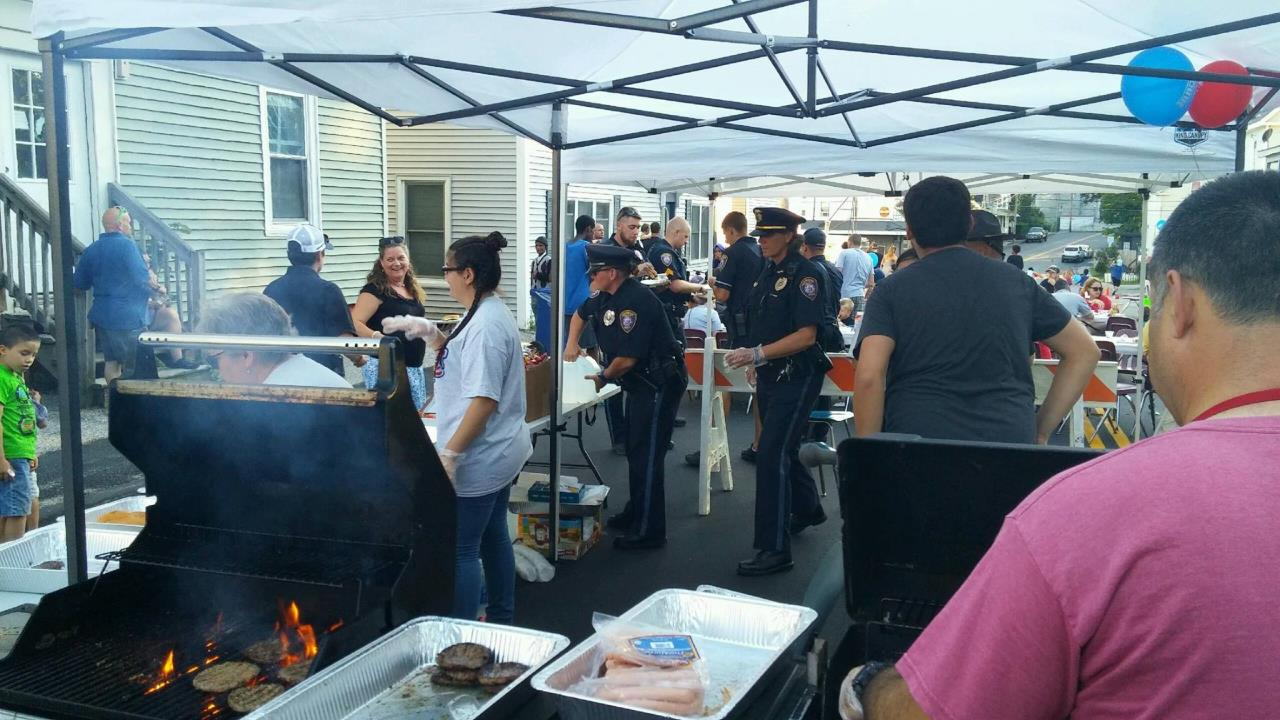 National Night Out Event With Officers Serving Food